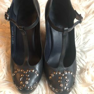 Chanel Mary Jane lucky charm wedges